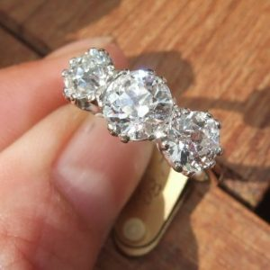 Old cut diamond trilogy ring almost 3 carats