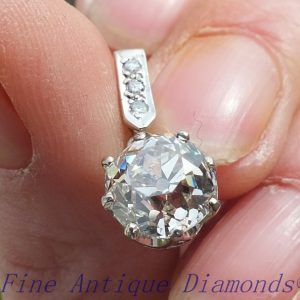 Antique cushion cut diamond platinum pendant