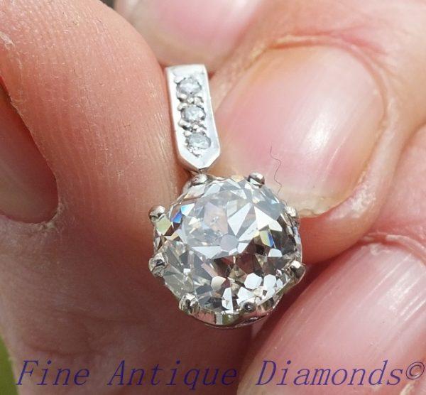Antique cushion cut diamond platinum pendant