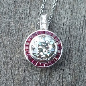 Old cut diamond pendant with ruby surround