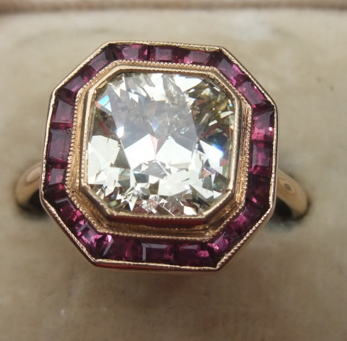 Absolutely fabulous 3ct old cushion cut diamond ring with ruby surround